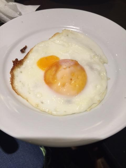 'Soft' fried egg that arrived after we had eaten breakfast