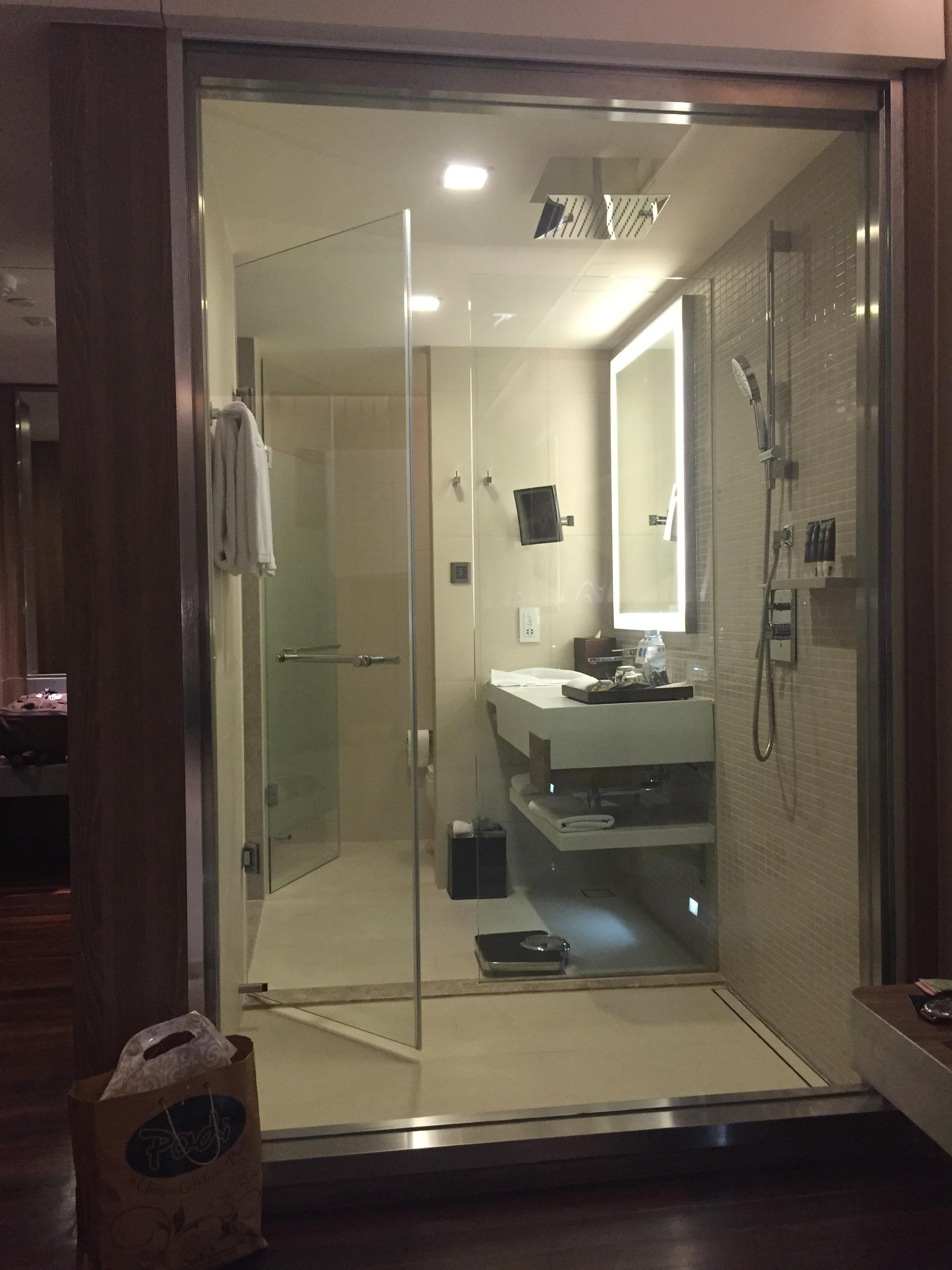 the shower with retracting shade