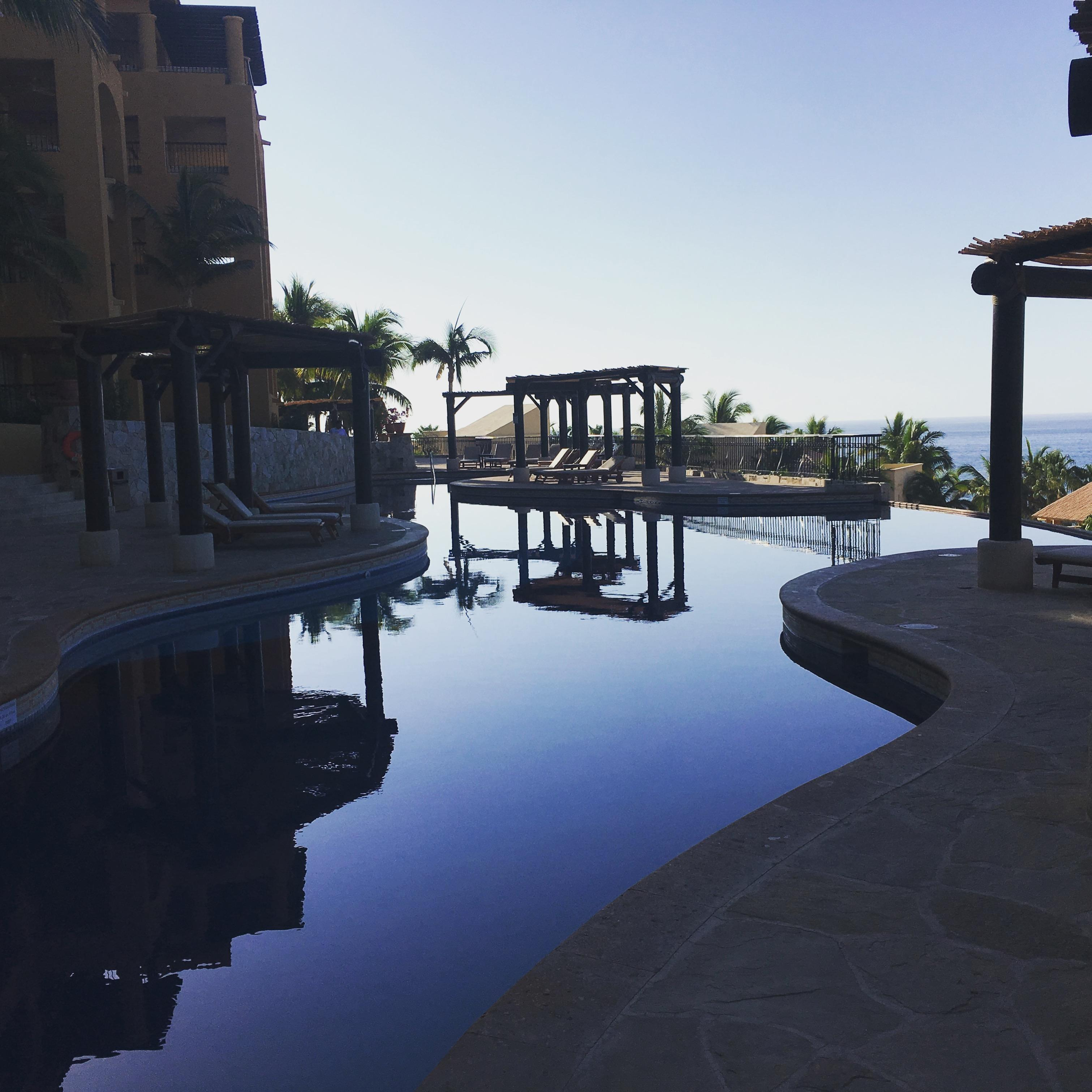 Early morning view of a semi private pool near the villas