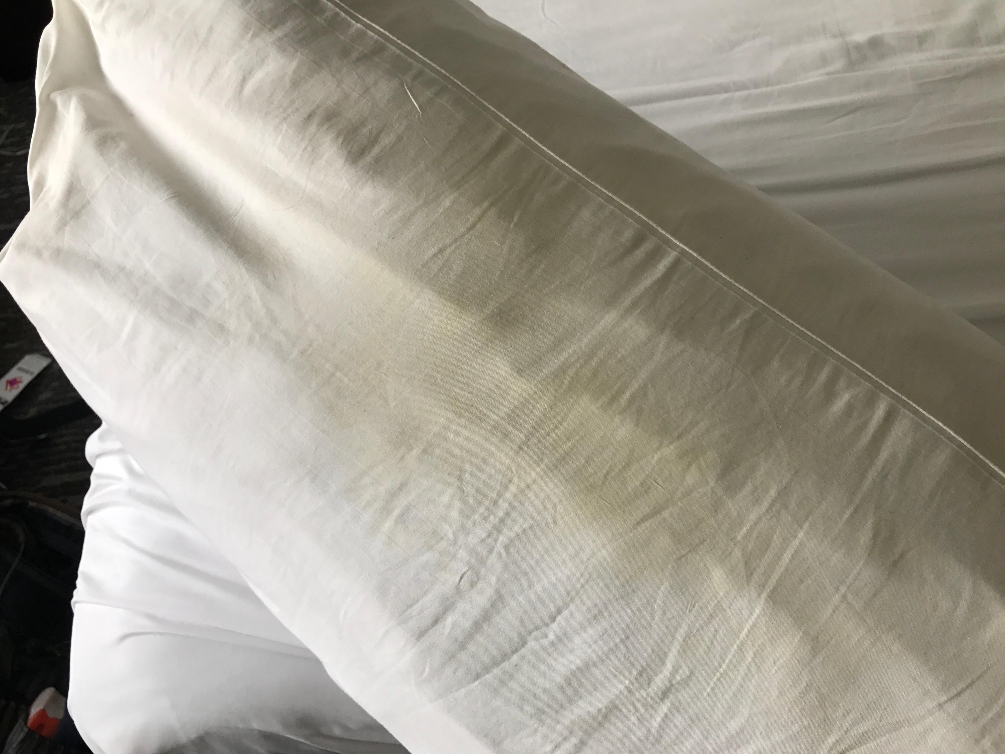 Pillow with yellow stains