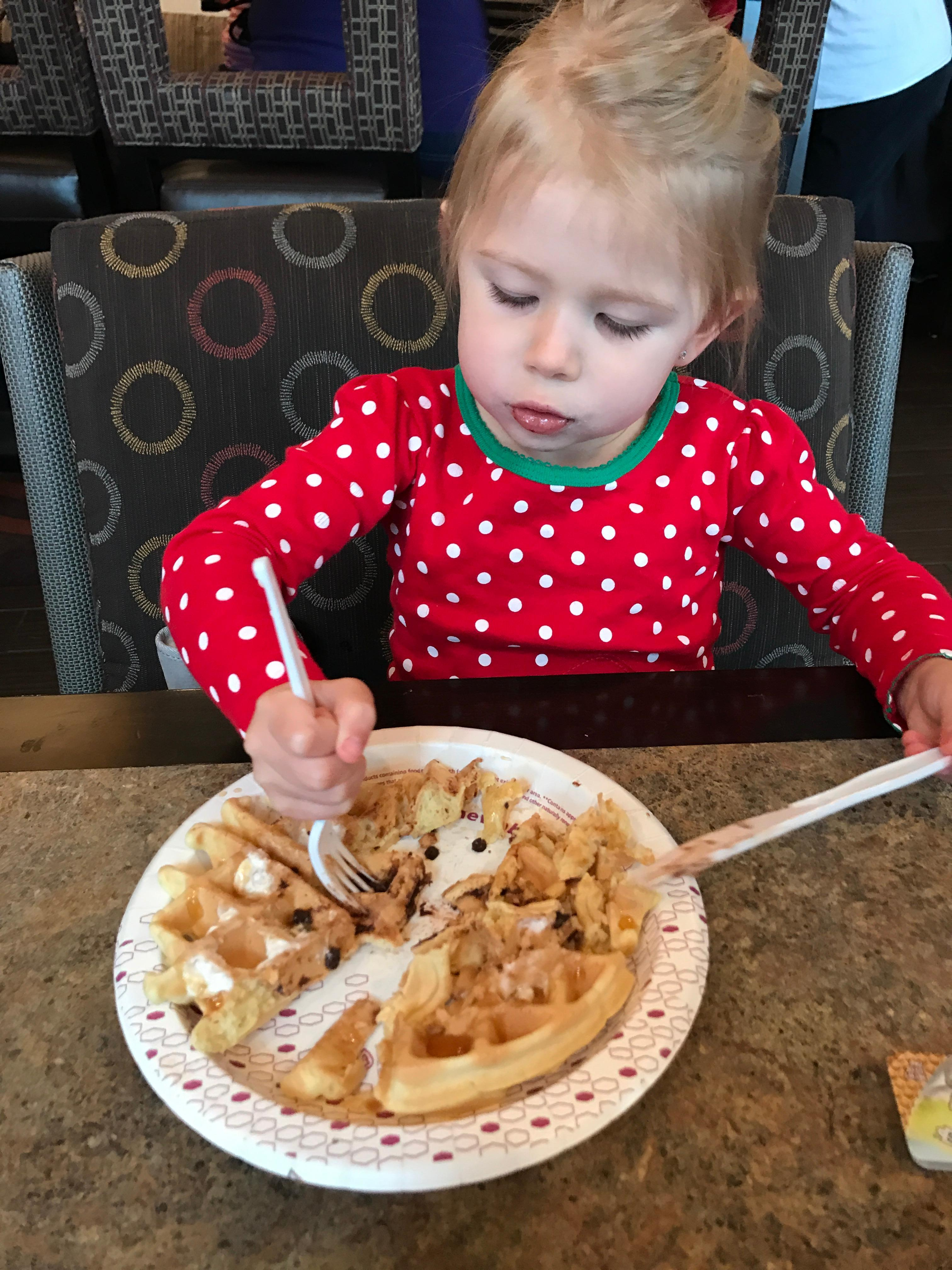 Loving the waffle at breakfast with yummy toppings.