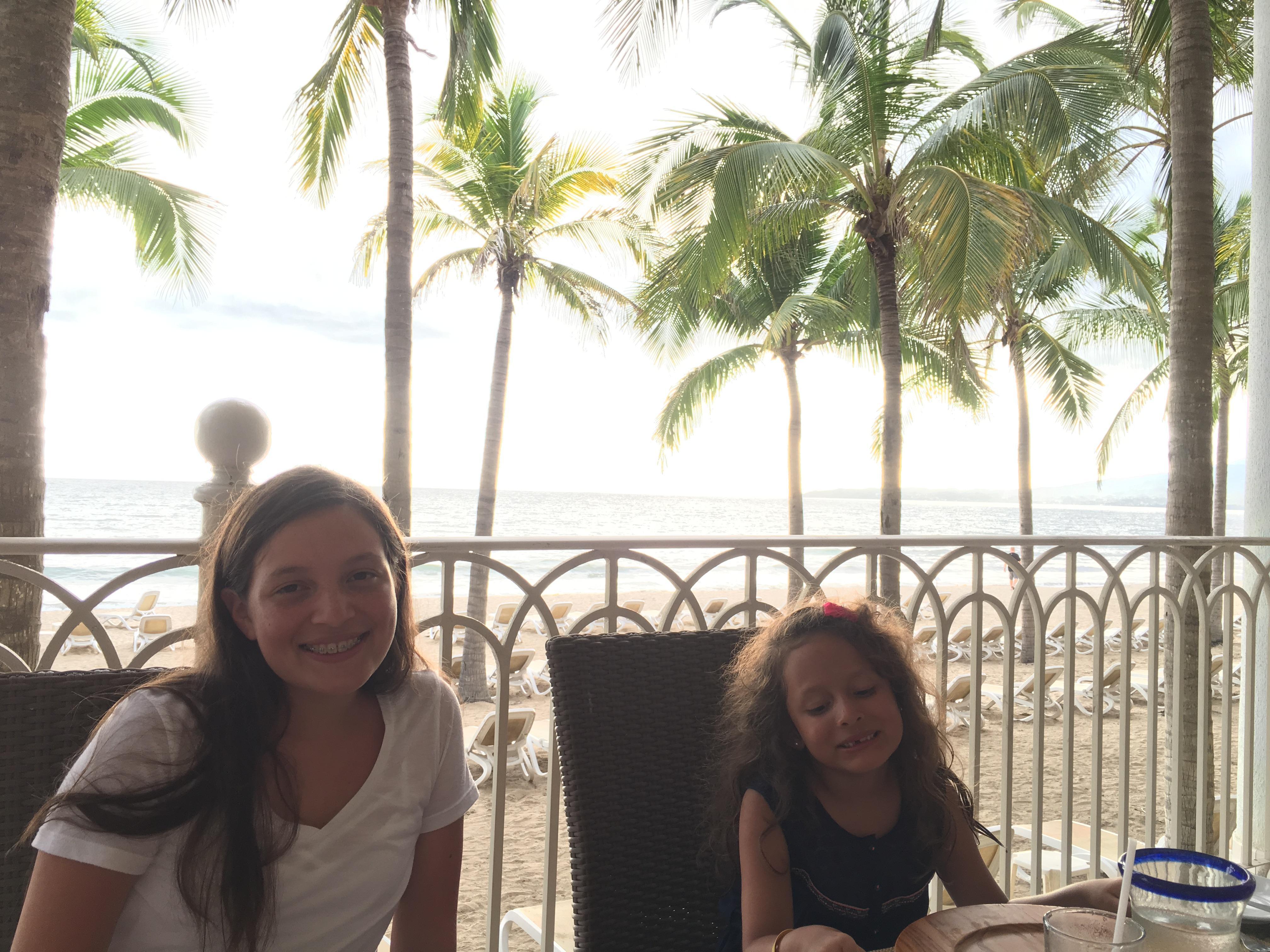 Eating dinner, ocean view.