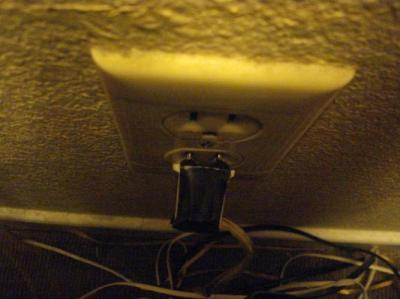 Electrical tape on the lamp cord, and yes its plugged into the outlet.