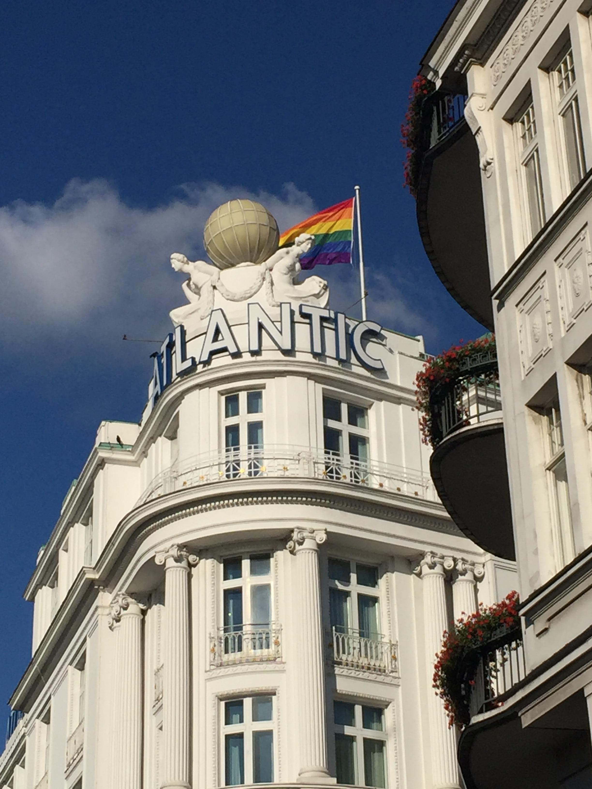 The famous globe symbol of the hotel and a rainbow flag for Pride Week