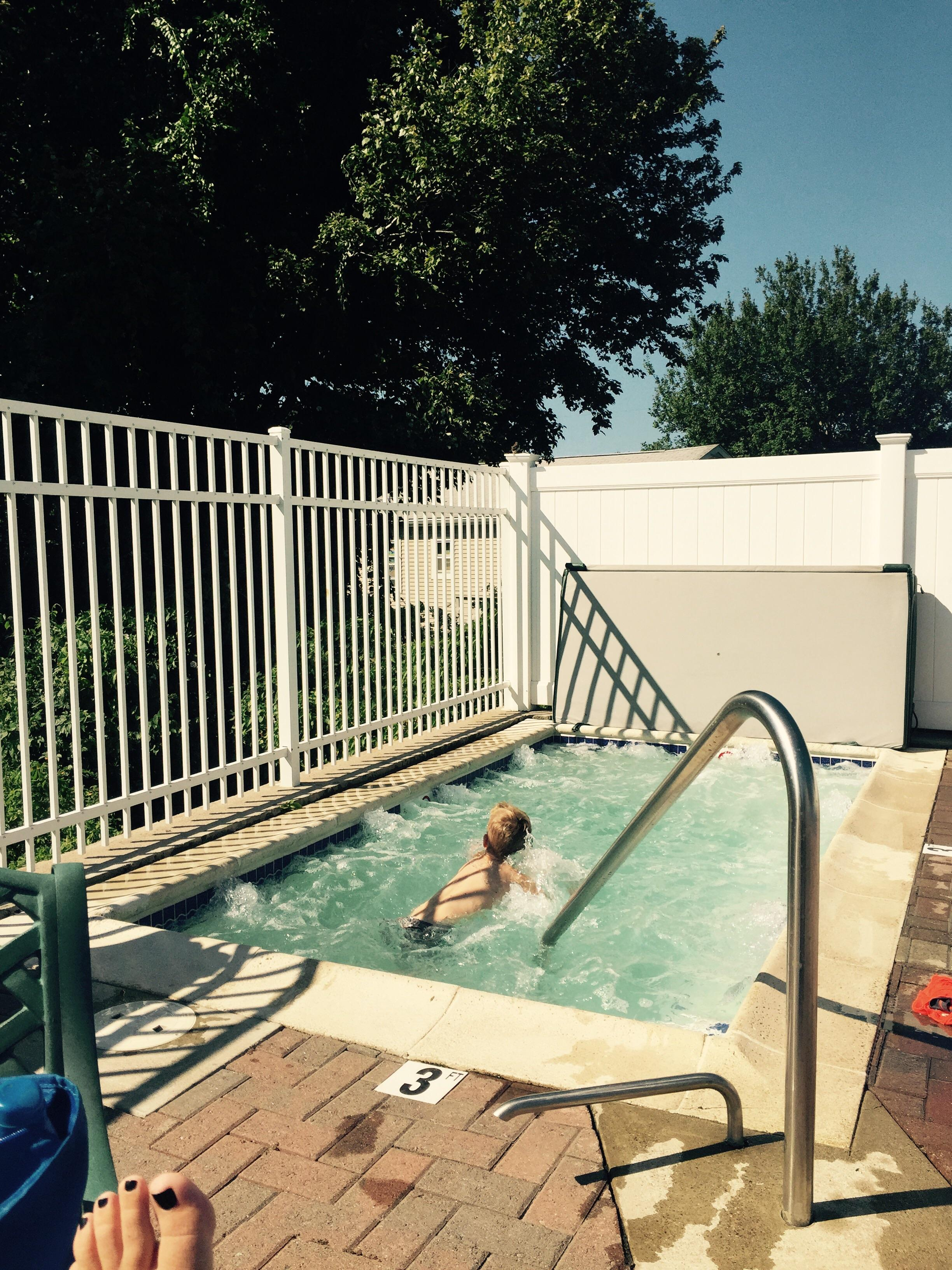 My son swimming in the hot tub