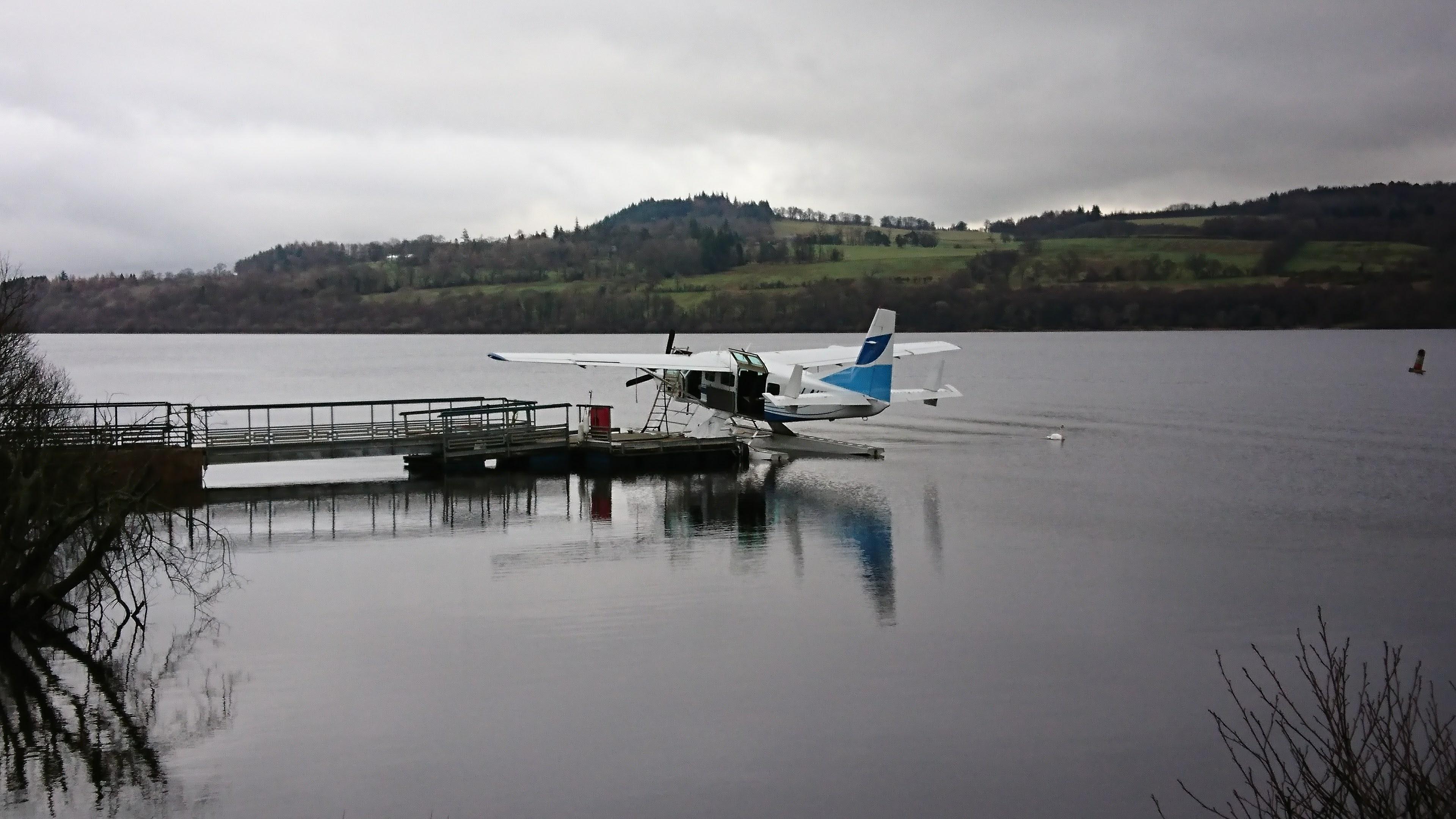 Seaplane on calm loch.