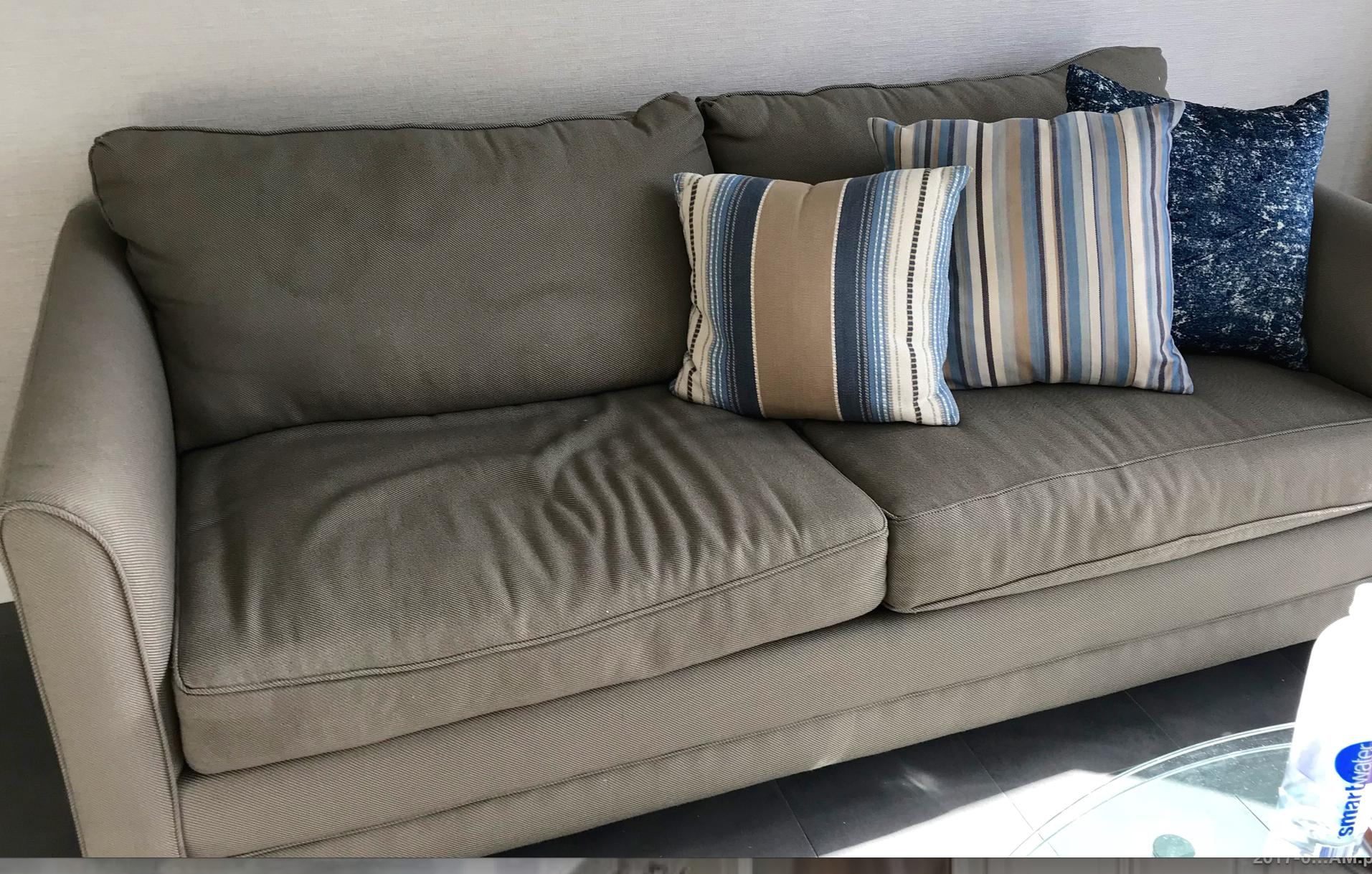 Stained, worn sofa bed