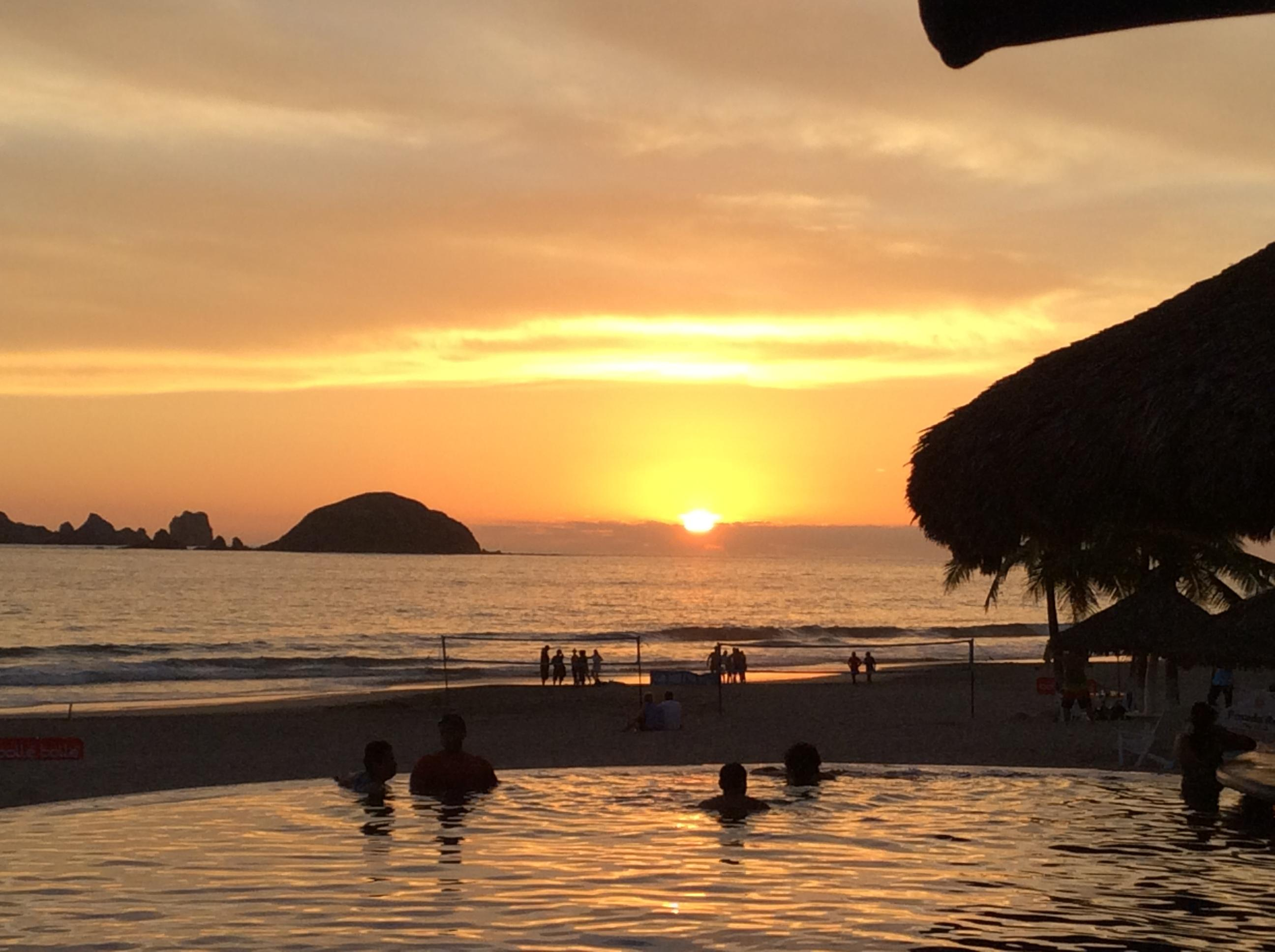 Sunset over the pool and ocean