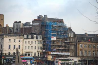 The view of the front during construction. Hotel also extends off to the left of the scaffolding.