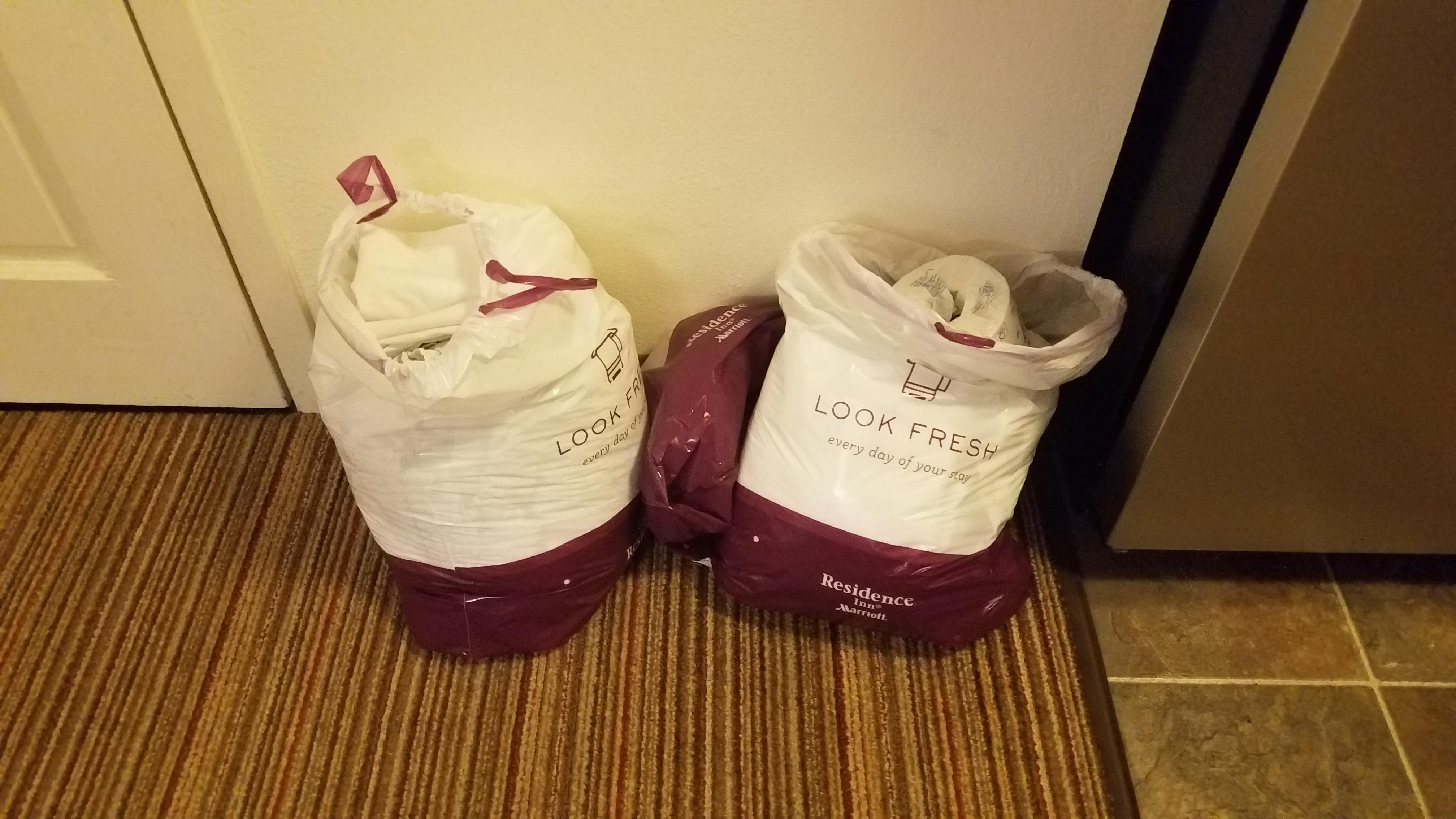 The bags of towels and sheets after no show on housekeeping